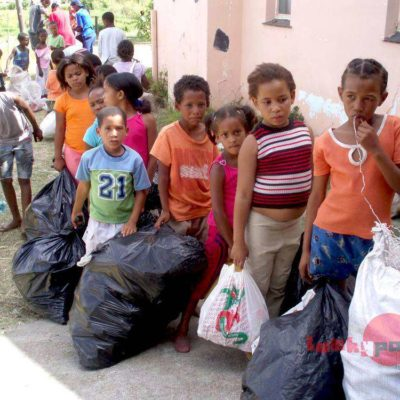 Children in line with collected trash