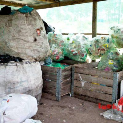 Soting rubbish in the recycling shed