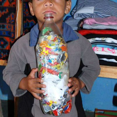 Boy holding filled cold drink bottle