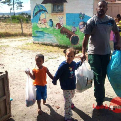 Family bringing rubbish they collected