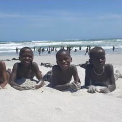 Boys enjoying the warm beach sand