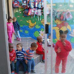 Anxious children peering in