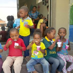 Children eating snacks of yoghurt