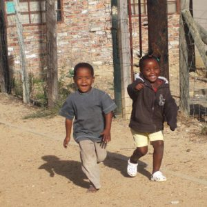 Happy children running in the street