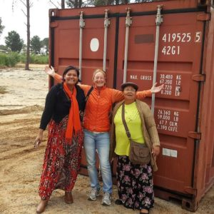Claudia Margrit and Elizabeth in front of a container
