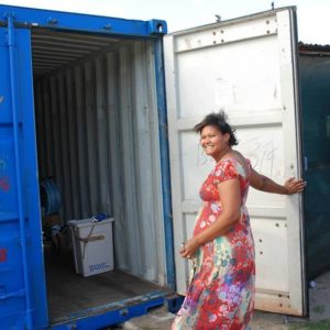Claudia opening the container