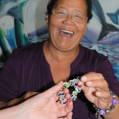 Elizabeth is presented with one of the hand-made bracelets