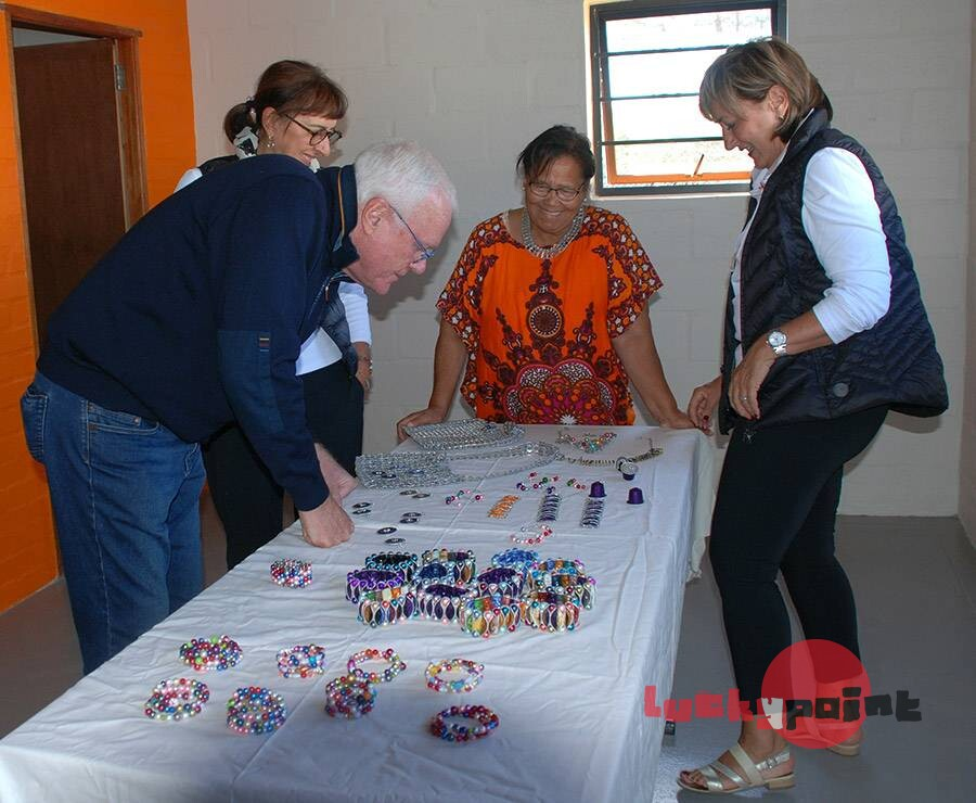 Visitors admiring Nespresso capsule jewellery made at the Lucky Point Youth Centre