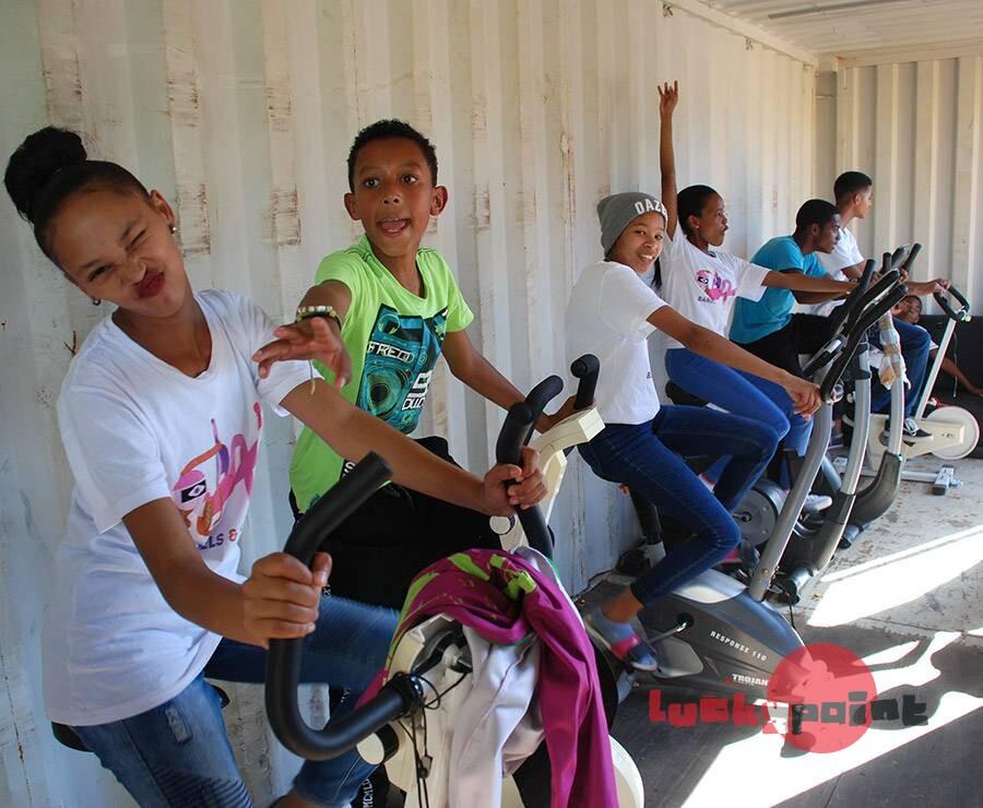 Youths enjoying the excerise bikes