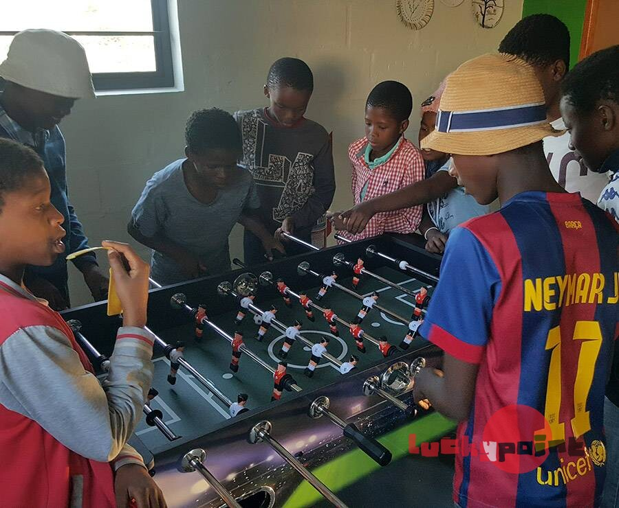 Champions playing the soccer table