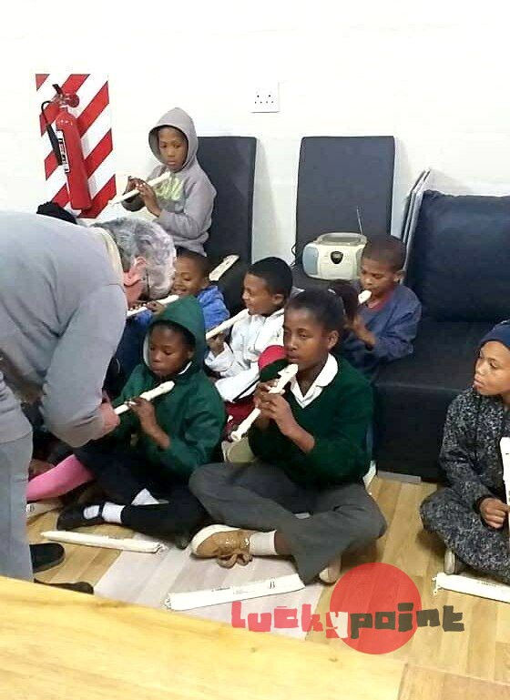 Children learning to play the flute