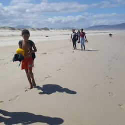 Children walking along the beach from Meerensee to Kleinmond on an outing